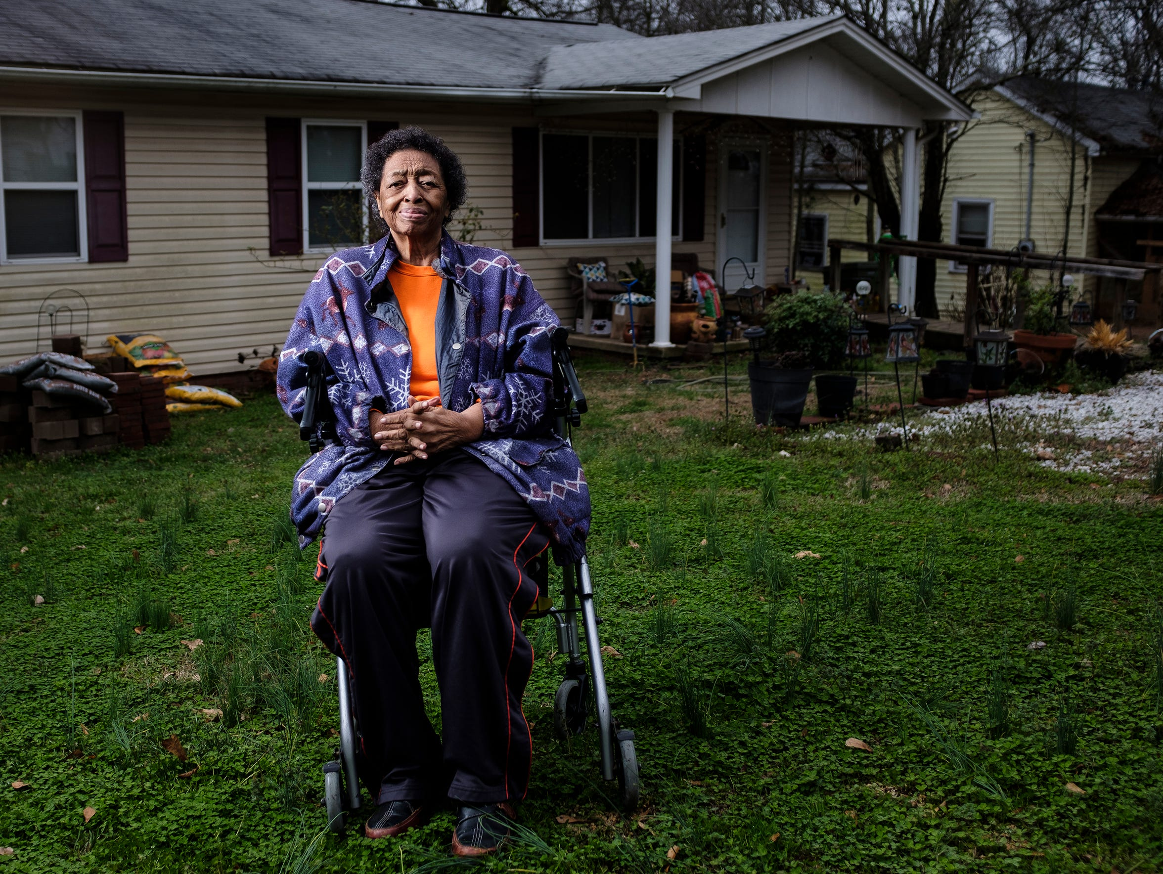 Ann Warren, 83, sits in front of her home in the Calhoun