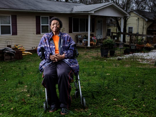 "Ann Warren, 83, sits in front of her home in the Calhoun neighborhood of the city of Clemson. The home used to be her mother's and is where she and her sister Dorothy Jones grew up. ""I've lived here all my life. This is all we know,"" Warren says. ""It's all we got."""
