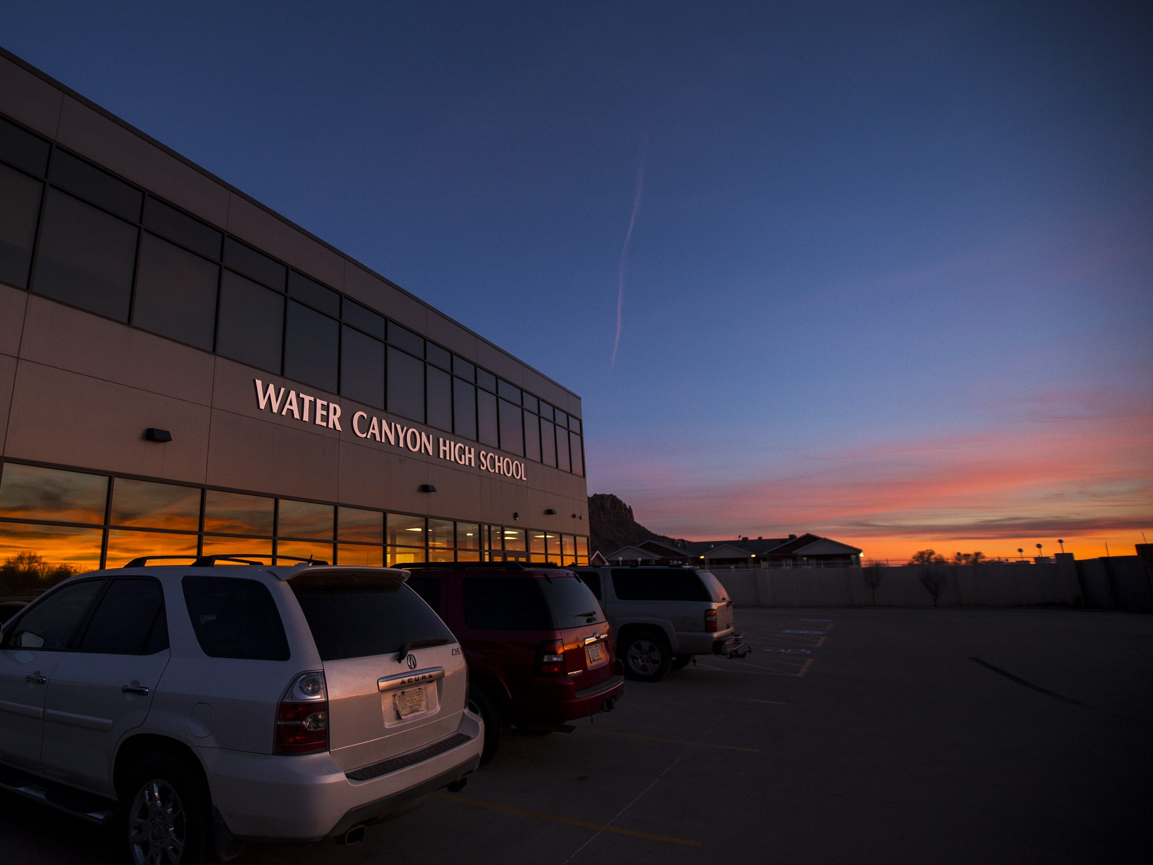 The sun sets behind Water Canyon High School School