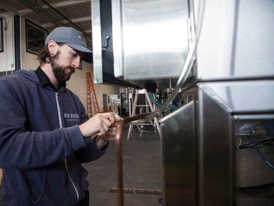 Andy Joynt, brewer at Big Grove Brewery works on the