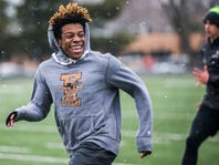 Jayson Murray, Dowling's speedy running back, is pretty fast on the track, too