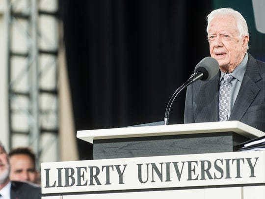 Former president Jimmy Carter speaks at the 45th Liberty University commencement at Williams Stadium on Saturday May 19, 2018, in Lynchburg, Va.