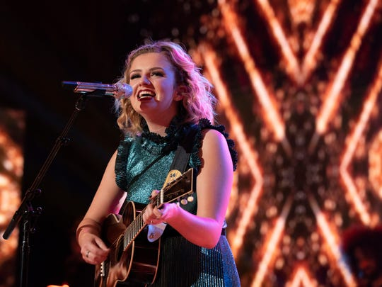 """American Idol"" winner Maddie Poppe of Clarksville, Iowa, performs Monday, May 21, 2018, during the live finale in Los Angeles."