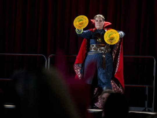 Mary Zeller, dressed as Doctor Strange, performs in