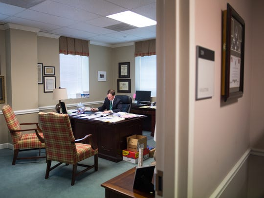 Thirteenth Judicial Circuit Solicitor Walt Wilkins reads a memo in his office on Tuesday, May 29, 2018. Last week, Republican candidate for governor, Catherine Templeton, announced Wilkins would be her running mate.