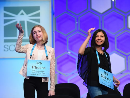 Phoebe Smith, left, and Melodie Loya during a break Thursday at the 2018 Scripps National Spelling Bee at the Gaylord National Resort and Convention Center.