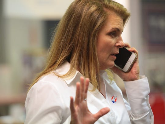 Kimberlin Brown Pelzer receives news from her campaign on initial election results in La Quinta, Calif., Tuesday, June 5, 2018. She is running to represent CA-36 in the United States Congress.