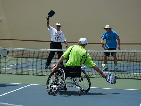 Wheelchair pickle ball player Mike O'Leary makes a