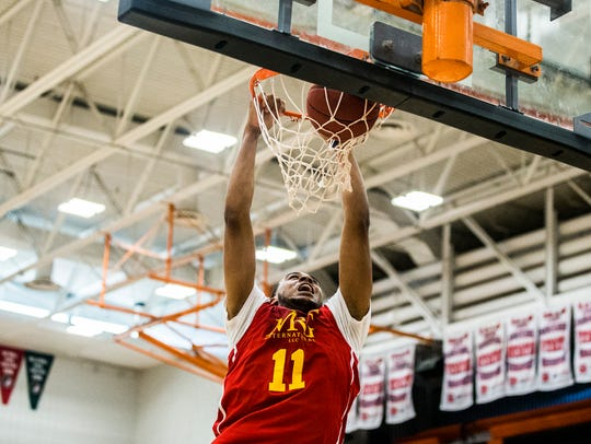 Iowa State's Talen Horton-Tucker dunks during opening