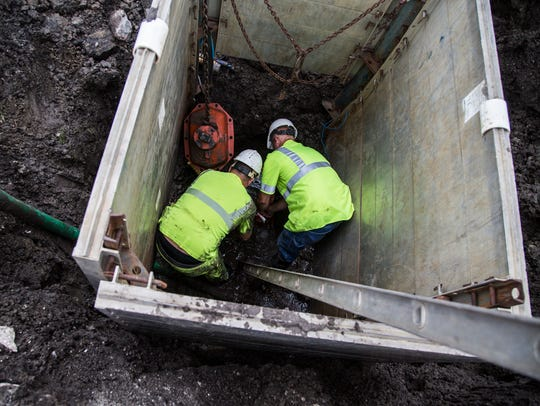 A crew from the City of Ankeny works to repair a water