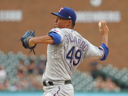 Texas Rangers' Yovani Gallardo throws a first-inning