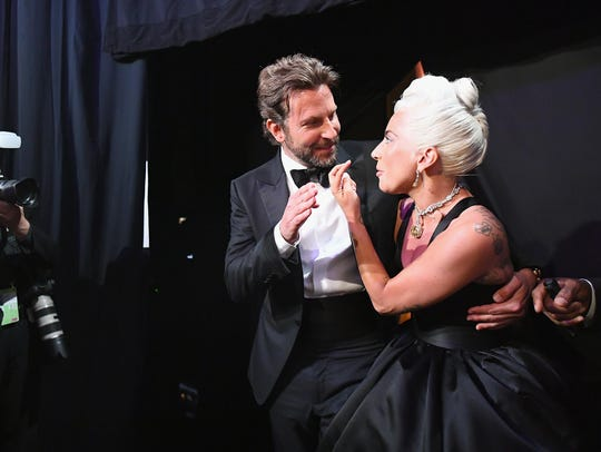 Bradley Cooper and Lady Gaga backstage during the 91st