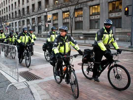 A group of Pittsburgh police on bicycles ride around the courthouse on the first day of the trial for Michael Rosfeld, a former police officer in East Pittsburgh, Pa., begins on  March 19, 2019, in Pittsburgh. Rosfeld is charged with criminal homicide in the fatal shooting of Antwon Rose II as he fled during a traffic stop on June 19, 2018.