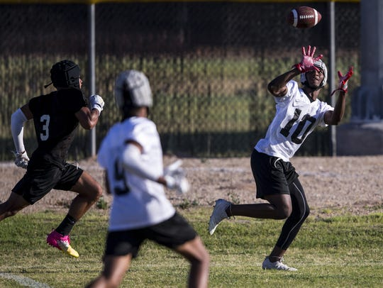 Desert Edge wide receiver Jihad Marks catches a pass