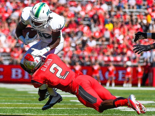 Tulane's Leondre James is tackled by Rutgers' Gareef Glashen in September.