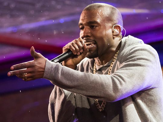 In this Dec. 1, 2014 file photo, Kanye West performs during the World AIDS Day (RED) concert In Times Square in New York.