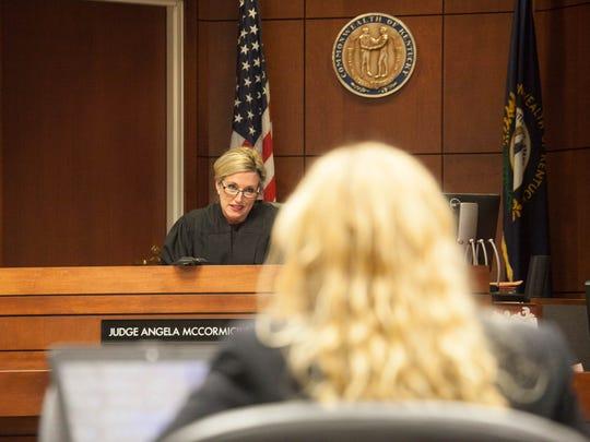 Judge Angela McCormick Bisig talks to attorneys as the jury deliberates during Dejuan Hammond's murder trial. Dec., 4, 2014