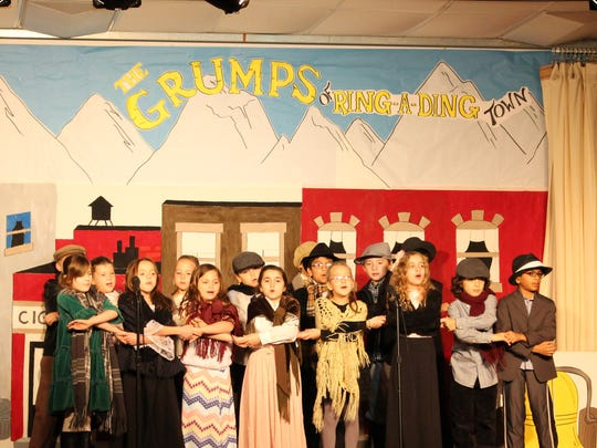 "Woodland third graders put on a lively holiday performance of ""The Grumps of Ring-A-Ding Town"" on Dec. 8."