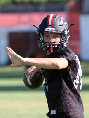 Boonton quarterback Gage Cabalar looks for a pass during football practice at Boonton High School Wednesday August 26, 2015.