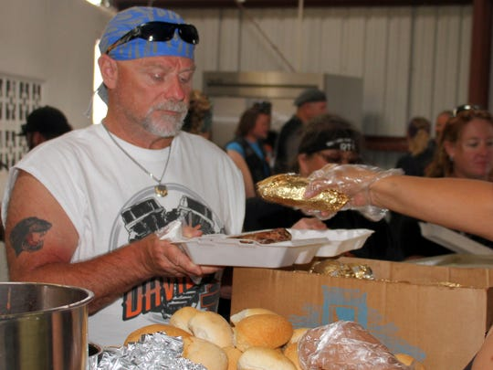 Volunteers served hungry riders brisket and brats will delicious sides and dessert.