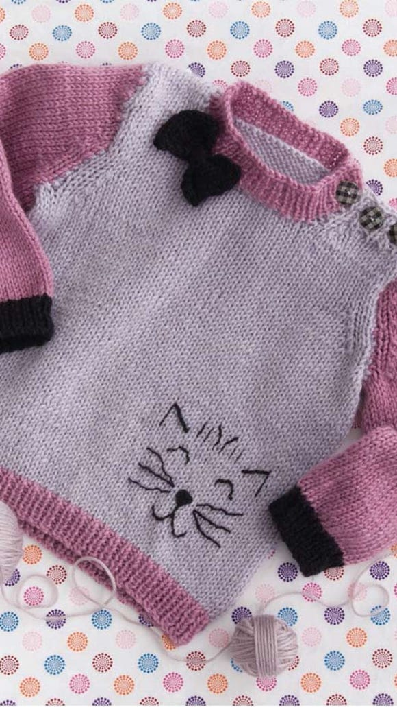 """This cute baby sweater is from """"60 quick knit baby essentials"""" from Sixth & Spring Books and Cascade Yarns. It was designed by Pat Olski."""
