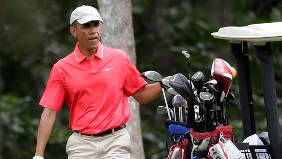 President Obama golfing in August.