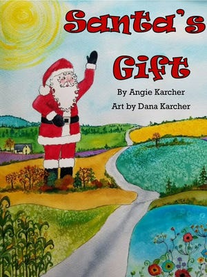 "The cover of a children's book written by Evansville native Angie Karcher and illustrated by Dana Karcher, her sister-in-law. ""Santa's Gift"" tells the story of a 35-foot Santa Claus statue that used to be a landmark on U.S. 41 and was restored in 2016 after it was noticed in a junkyard."
