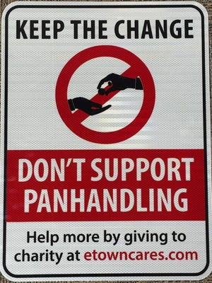 Signs have been posted in Elizabethtown encouraging people to give money to charitable causes instead of panhandlers. Aug. 2, 2018