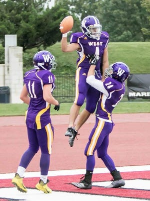 Topeka West product Joe Randles (24) celebrates a touchdown with teammate Dontrey Washington last fall. Randles has been named the 2020 Topeka Shawnee County most inspirational male athlete.