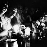 People in Manhattan drink by candlelight during a New York City blackout.
