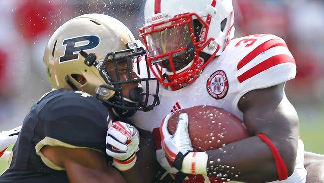 FILE - Purdue safety Taylor Richards helps bring down Imani Cross of Nebraska, Oct. 12, 2013, at Ross-Ade Stadium.