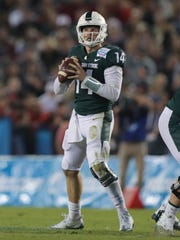 Michigan State quarterback Brian Lewerke passes against