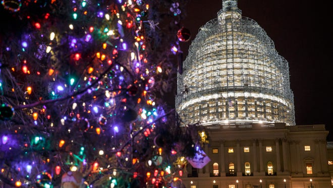 The Capitol Dome and the Capitol Christmas Tree are illuminated last week.