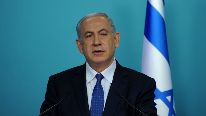 """Israeli Prime Minister Benjamin Netanyahu makes a statement to the press about negotiations with Iran at his office in Jerusalem on April 1, 2015. World powers must toughen their stance to reach a """"better"""" deal with Iran aimed at preventing it from obtaining nuclear weapons, Netanyahu said."""