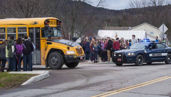 Students were evacuated from Champlain Valley Union High School in Hinesburg on Tuesday, December 15, 2015, after a staff member found a written bomb threat at the school.  They were bused to the town post office before being sent home for the day.