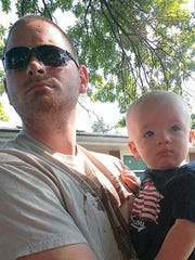 """Danny Judge with son Jack """"back in my heating and cooling days"""" before going to college."""