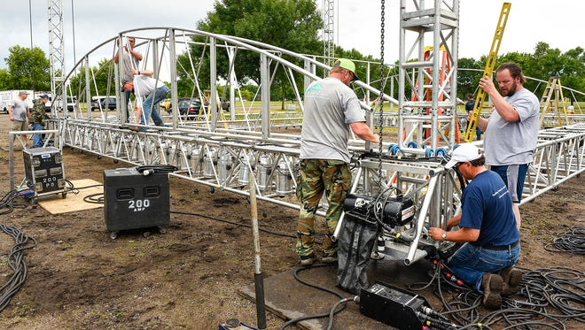 The frame for the lighting and speakers are assembled before being lifted over the stage Thursday, June 22, for the Liberty Bank Block Party at Whitney Park. This year's featured singer is Tommy James & The Shondells. A crew of 10 employees from Dale Gruber Construction joined the stage crew for the nine-hour assembly.