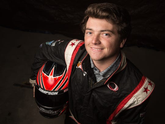Race car driver Devin Dodson poses for a photo on Wednesday,