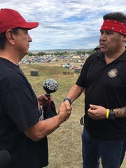 Anthony Andreas III, right, with the leader of Standing Rock, Chairman Dave Archambault II.