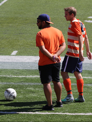 SPASH graduate Derek Marie (wearing hat) is eager to help Carroll University improve on a 3-14-1 record a year ago in his first season as the Pioneers head coach.