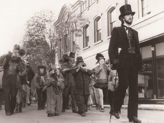 "Mr. Dark (Jonathan Pryce) leads an unusual parade in ""Something Wicked This Way Comes"" (1983)."