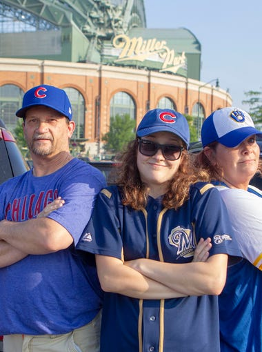 Bryon, Halie, and Tara Johnson (from left) of Janesville have a split family when it comes to their baseball allegiance. Bryon cannot give up the Cubbie blue, as he says he has been a Cubs fan since childhood.