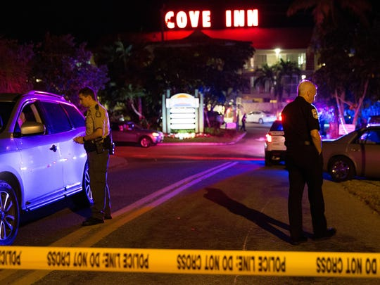 Authorities investigate an officer-involved shooting during a domestic violence incident at the Cove Inn in Naples on Friday, Nov. 25, 2016. According to Naples Police spokesman Seth Finman, one man was injured in the shooting after brandishing a weapon when the Naples officer arrived to the call.