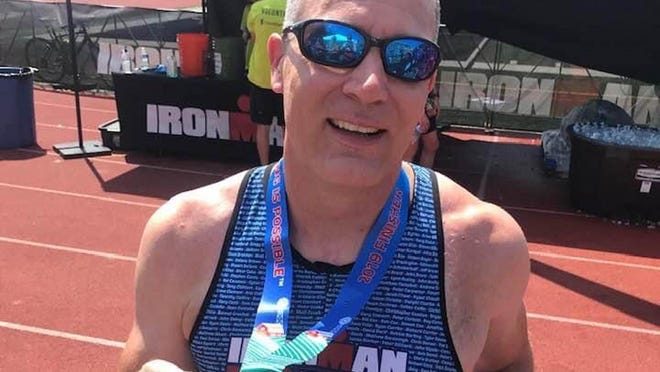 Steven Mauro, Gannon University's vice president for academic administration, is a triathlete who plans to complete an Ironman-distance triathlon in Erie on Saturday.