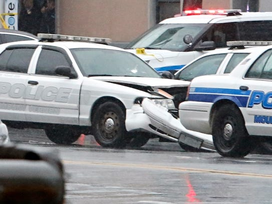 A Mount Vernon police cruiser is damaged at Bronx Boulevard