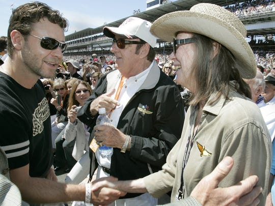 Russell Crowe, left, greets Mari Hulman-George before the 2005 edition of the Indianapolis 500. Jim Nabors is pictured at center.