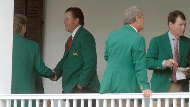 Phil Mickelson, second from left, shakes hands with Bernhard Langer of Germany during the Masters Champions Dinner at the Augusta National Golf Club in Augusta, Ga on April 3, 2007. Also pictured are past winners Tom Watson, far right, and Fuzzy Zoeller. The defending champion hosts the dinner. The rest of the past Masters champions have to figure out their own seat at the table.