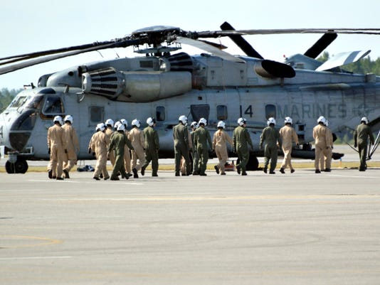 636131804525752213-Student-Naval-Aviators-walk-out-to-flight-line-to-board-MH-5.jpg