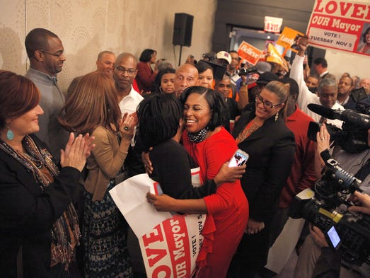 Rochester Mayor-elect Lovely Warren, center, is congratulated by supporters.