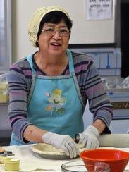 June Aoki prepares pie crusts for the Obon Festival's